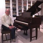 Karl Theil, MD, at a 1929 Knabe Ampico B player grand piano.