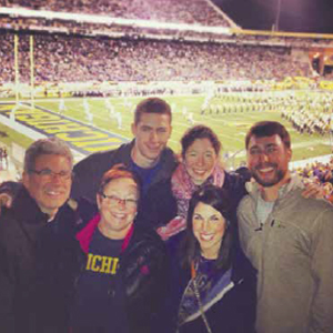 Dr. Tallman with his wife, Wendy, and their four children (Jacob, Sarah, Miriam, and Sam) at a Michigan football game.